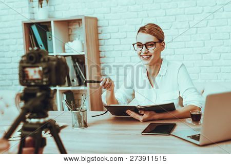 Blogger Makes A Video. Blogger Is Businesswoman. Video About A Business. Man Operator Shoots A Video
