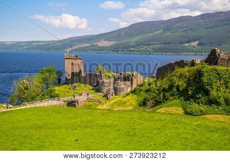 The Urquhart Castle. Medieval Castle On The Shores Of Loch Ness In The Mountains Of Scotland