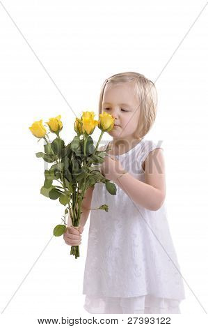 Florist:  Little Girl Preparing A Boquet Of Yellow Roses.