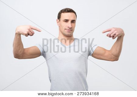 Italian Man In White T-shirt, Standing, Pointing Himself And Looking With Serious Egoist Face.