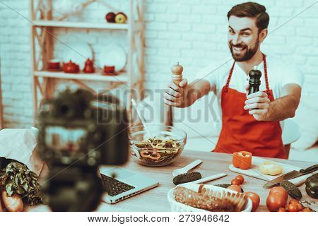 Blogger Makes A Video. Blogger Is Smiling Beard Man. Video About A Cooking. Camera Shoots A Video. L