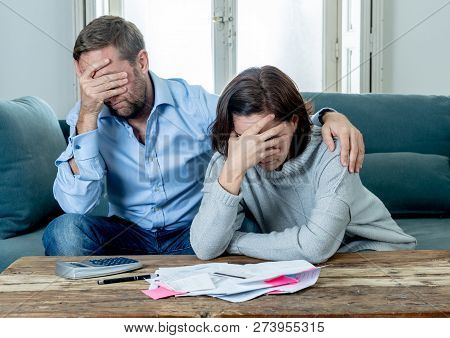 Young Couple Feeling Sad And Stressed Paying Bills Debts Mortgage Having Financial Problems