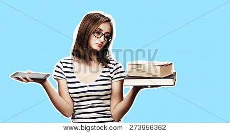 Contemporary Education Concept. Book Vs E-book. Girl Student Holding Traditional Textbook And Ebook