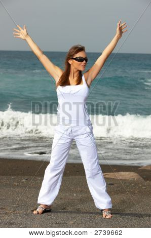 Woman On The Black Beach