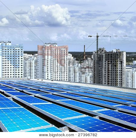 solarpanel on roof of building that is new microdistrict