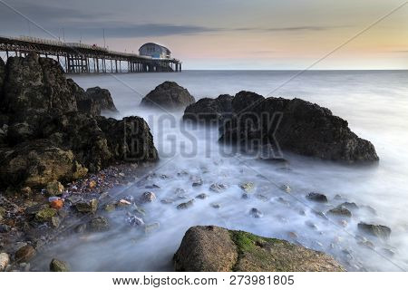 Daybreak And A Long Exposure At High Tide Around Mumbles Pier In Swansea, South Wales, Uk