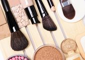 Make-up products for perfect complexion: concealer, primer, foundation, powder, blush with makeup brushes poster