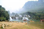 Cao bang, Vietnam - Nov 30, 2018 : Tourist visiting Ban Gioc Waterfall or Detian Falls by Bamboo boat poster