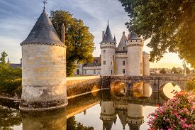 Castle Or Chateau Of Sully-sur-loire At Sunset, France. This Old Castle Is A Famous Landmark In Fran
