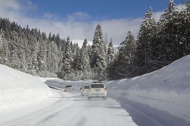 Winter Landscape With Cars On The Road In Snowy Forest.
