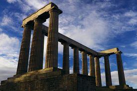 View Of The National Monument Of Scotland On Calton Hill (edinburgh, Scotland, Uk) Against A Deep Bl