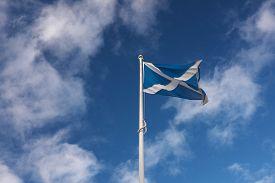 The Scottish Flag (saltire) Flies Against A Deep Blue Sky On A Bright Day. Taken At Edinburgh Castle