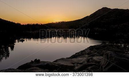 Sunrise At He Sierra Nevada Near Island Lake, California, Featuring The Rugged Terrain And Warm Ligh