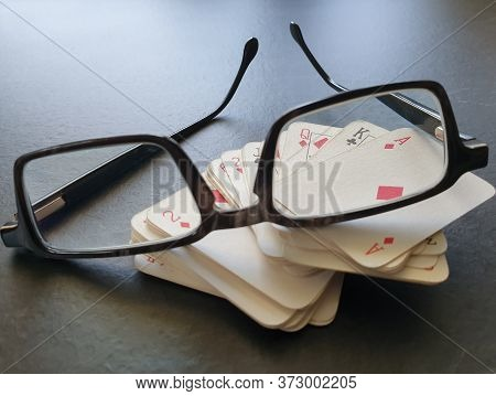 Glasses And Deck Of Poker Cards On Table As Symbol For Gambling. Indoor Home Isolation Activity, As