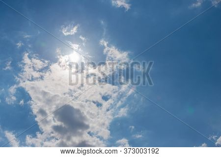 Whirling Clouds In The Sky.\nsunny Day. Slightly Cloudy Sky. Puffy Clouds Float In The Sky. They Are