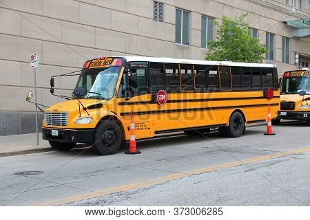 Kansas City, Usa - June 25, 2013: Typical American School Buses In Kansas City, Missouri. In 2015 48