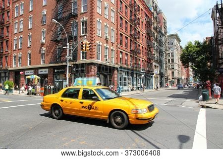 New York, Usa - July 2, 2013: People Ride Yellow Taxi Cab In Soho, New York. As Of 2012 There Were 1