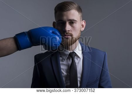 Close-up Portrait Of A Young Bearded Guy In A Business Suit, Businessman, Side View The Hand Of An O