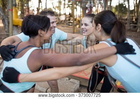 Fit friends forming huddle in park