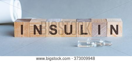 The Word Insulin Wooden Cubes With Black Letters, Hormone Insulin, Diabetes Treatment Gray Backgroun