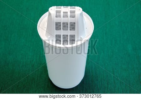 Replaceable Module For Cleaning Tap Water In A Filter Jug, On A Green Background. Coal Purifier For