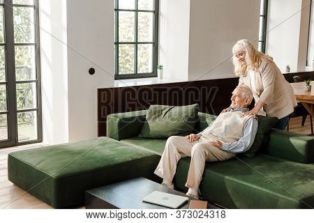 Senior Husband And Wife Doing Massage And Chilling At Home On Quarantine