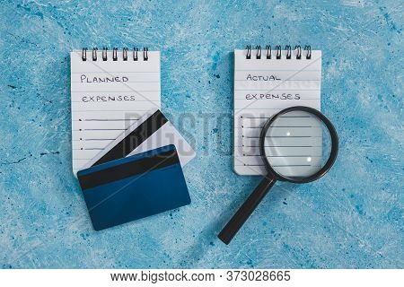 Managing Money And Finance Concept, Planned Expenses Vs Actual Expenses Notepads Side By Side With C
