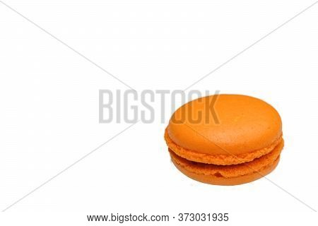 An Orange Flavored Macaroon With Chocolate Filling, Macro Top View Clean Minimal Style, Isolated On