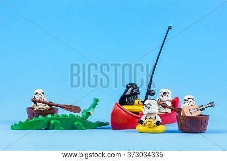 Bangkok, Thailand - June, 08, 2010 : Lego Star Wars Is Rowing Away From The Crocodiles Isolated On A