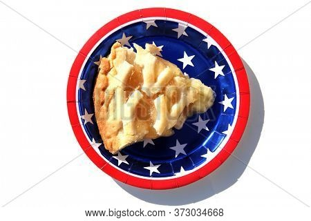 Apple Pie. Fresh Baked Apple Pie. Isolated on white. Lattice top Apple Pie. Section of Fresh Baked Pie on an American Flag design Paper Plate.