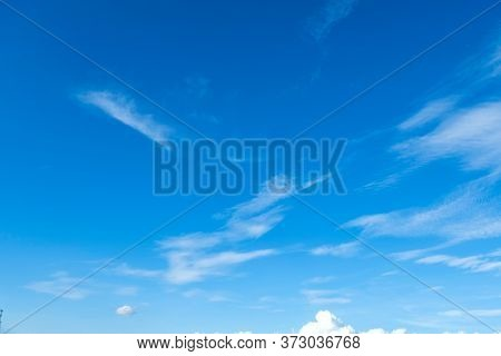 Blue Sky Background With Some Clouds Showing High Altitude Cirrus With Some Low Level Cumulus.