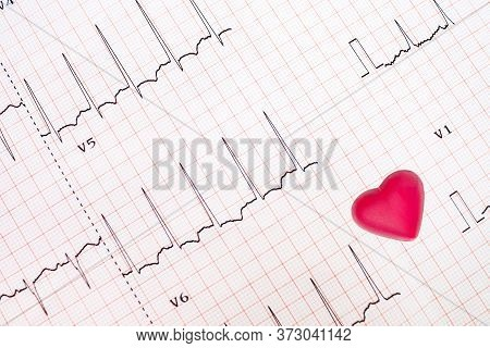 An Abnormal Electrocardiogram Tracing (lateral Wall Ischemia)  And A Red Heart-shaped Object, Heart