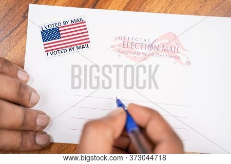 Maski, India - 23, June 2020 : Hands Filling Out Mail Postel Stamp, Concept Of Voted By Mail During
