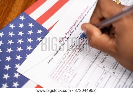 Maski, India - 23, June 2020 : Close Up Of Hands Filling President Voter Registration Application Wi