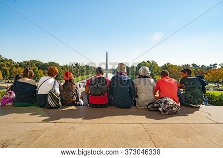 Washington Dc Usa - October 26 2014; Line Of Teenagers Sitting On Top Step Of Lincoln Memorial Facin