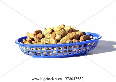Peanuts. Salted whole in shell roasted Peanuts. Isolated on white. Roasted Peanuts in a container ready for eating.