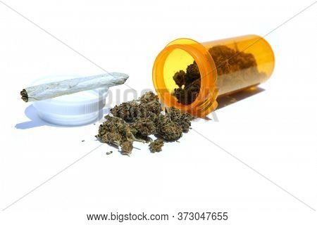 Medical Marijuana in a plastic Stash Jar with a Rolled Joint. Cannabis. Medical Marijuana. Recreational Marijuana. Prescription Marijuana and Cannabis in a Pill Bottle.