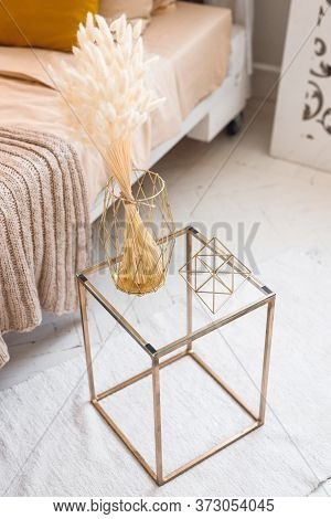 Modern Exposition With Metal Cube And Dried Flowers