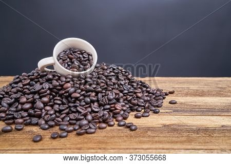 Coffee Bean In White Cup Place On Pile Coffee Bean