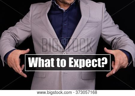 What To Expect Text Is Written On The Background Of A Businessman In A Gray Suit. Business Concept