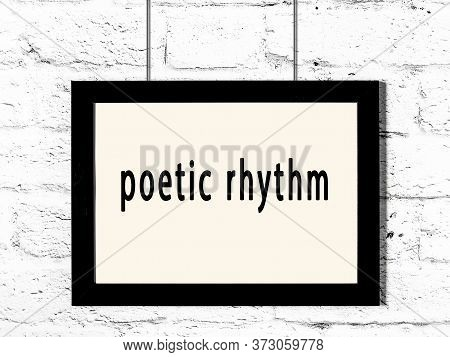 Black Wooden Frame With Inscription Poetic Rhythm Hanging On White Brick Wall