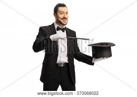Magician performing a hat-trick with a magic wand isolated on white background