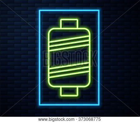 Glowing Neon Line Sewing Thread On Spool Icon Isolated On Brick Wall Background. Yarn Spool. Thread