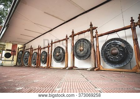 The Ancient Big Gongs In Wat Phra Pathomchedi, Nakhon Pathom Province, Thailand.