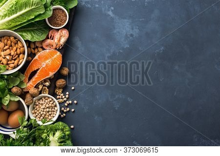 Food Sources Of Omega 3 On Dark Background With Copy Space Top View. Foods High In Fatty Acids Inclu