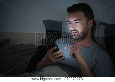 One Guy Texting On Cellphone Late At Night