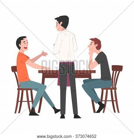 Two Guys Sitting At Table In Cafe And Waiter Serving Them, People Drinking Coffee And Relaxing At Co