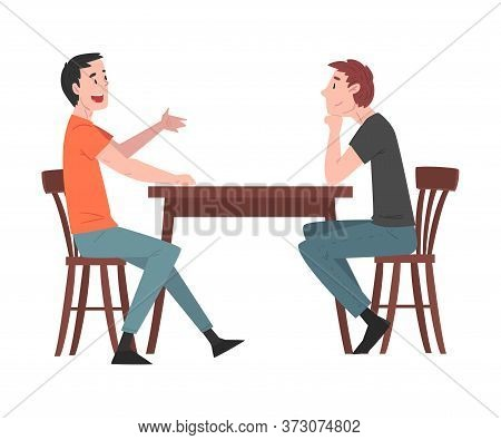 Two Guys Sitting At Table In Cafe, People Drinking Coffee And Relaxing At Coffeehouse Or Coffee Shop