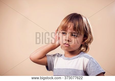 Kid Showing Eavesdropping Gesture . Children And Emotions Concept
