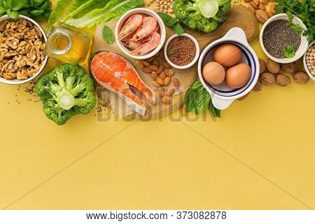 Omega 3 Food Sources And Omega 6 On Yellow Background Top View Copy Space. Foods High In Fatty Acids